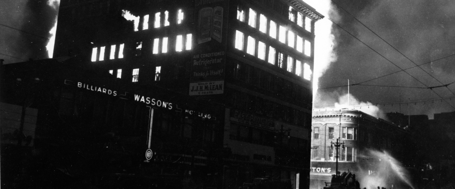 Royal Winnipeg Ballet Archives. The Times Building at the corner of Hargrave and Portage in Winnipeg,  during the early stages of a fire which destroyed the building and others around it, including the RWB headquarters. All the ballet records were also destroyed. Photograph by Jack Ablett, June 8, 1954.